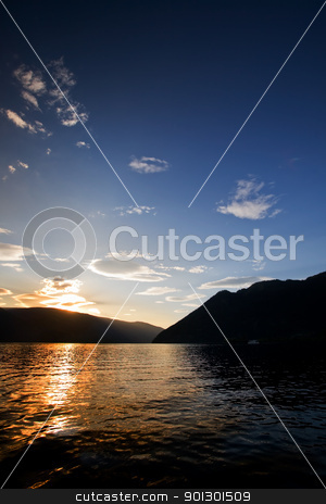 Mountain Reflection Sunset stock photo, Reflection in the water at sunset by Tyler Olson