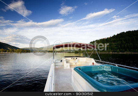 Luxury Boat stock photo, A luxury house boat on a beautiful lake by Tyler Olson