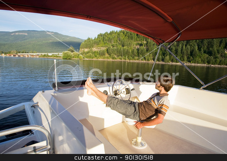 Luxury Boat stock photo, A young male enjoying a luxury boat by Tyler Olson