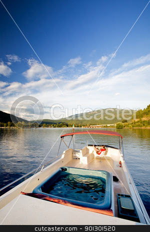 Woman on Yacht stock photo, A young woman driving a yacht from the upper helm by Tyler Olson