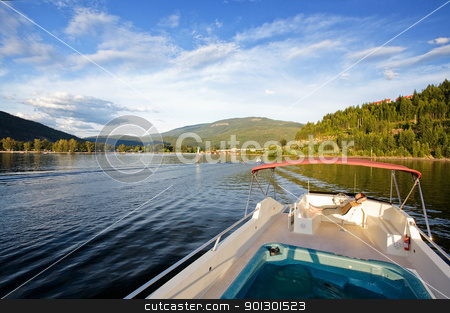 Relax on Boat stock photo, A young male relaxing on a luxurious house boat yacht by Tyler Olson
