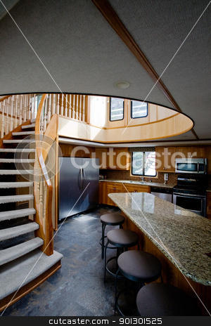 Luxury yacht interior stock photo, A luxury yacht interior - kitchen and second floor by Tyler Olson
