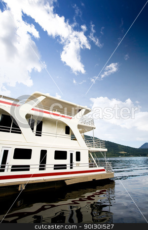 Luxury House Boat stock photo, A house boat on a lake on a beautiful day by Tyler Olson