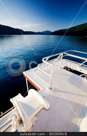 Luxury House Boat stock photo, A slide off a luxury house boat into a beautiful lake by Tyler Olson