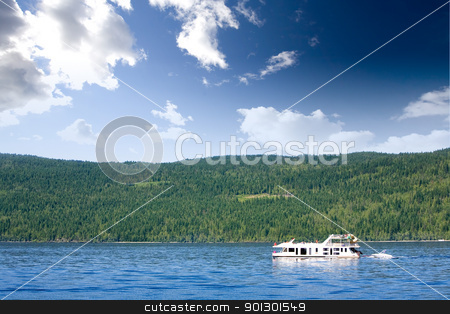 Luxury House Boat stock photo, A luxury house boat on a lake in the summer by Tyler Olson