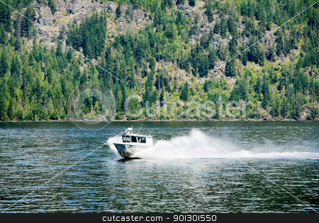 Rescue Boat stock photo, A rescue maintenance boat on a lake by Tyler Olson