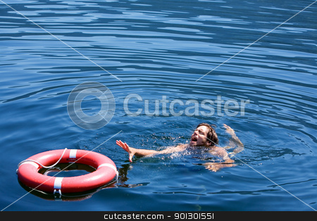 Drowning Man stock photo, A man struggling for a life buoy in the water by Tyler Olson