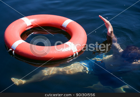 Person Drowning stock photo, A person in a large body of water drowning by Tyler Olson