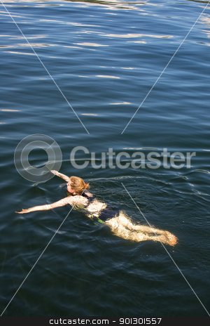 Woman Swimming stock photo, A woman swimming in fresh water by Tyler Olson