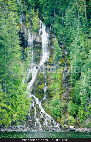 Waterfall Background stock photo, A beautiful waterfall going down a mountain side by Tyler Olson