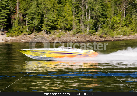 Speedboat on Lake stock photo, A speedboat on a lake - motion blut on the background with the boat sharp by Tyler Olson