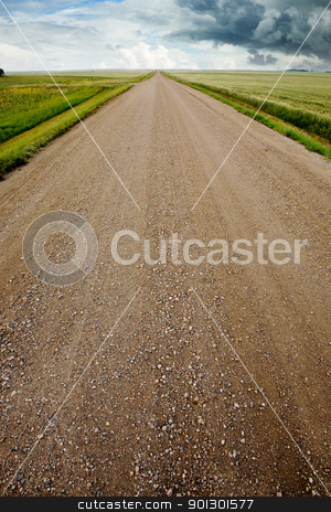 Prairie Storm Landscape stock photo, A prairie storm and a gravel road by Tyler Olson