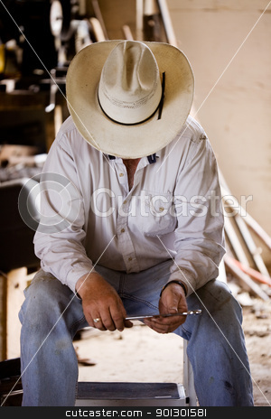 Tired Farmer stock photo, A farmer taking a break by Tyler Olson