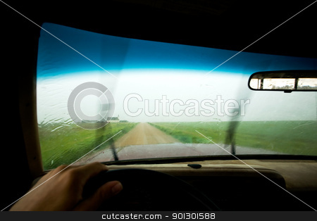 Driving in Rain stock photo, An abstract of a truck driving in rain by Tyler Olson