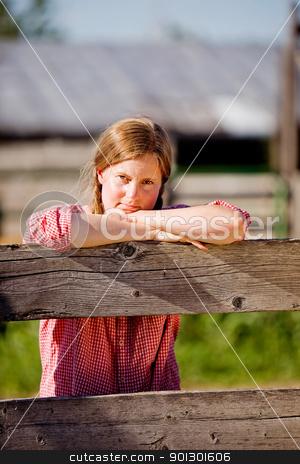 Country Farm Girl stock photo, A country farm girl taking a break by Tyler Olson