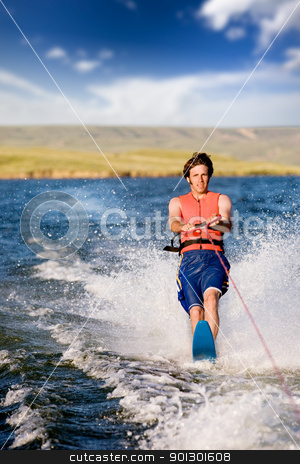 Water Skiing stock photo, A man water skiing on a lake by Tyler Olson