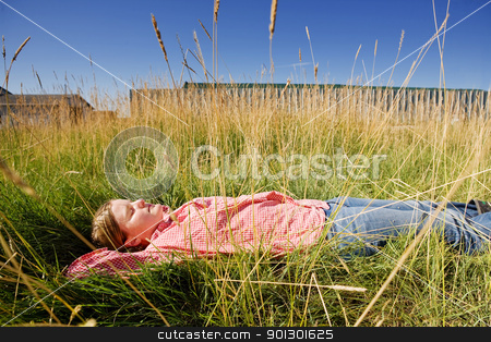 Farm Girl stock photo, A farm girl relaxing in the grass by Tyler Olson