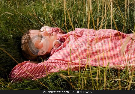 Farm Girl stock photo, A farm girl relaxing in the grass by Tyler Olson
