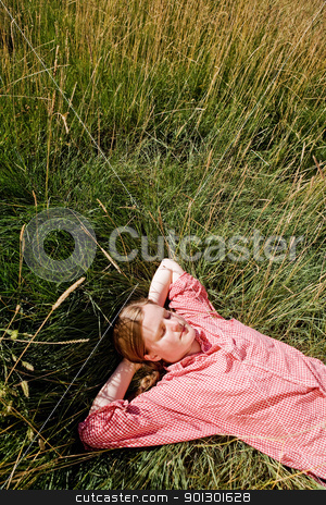 Farm Girl stock photo, A country farm girl relaxing in the grass by Tyler Olson
