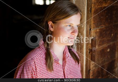 Farm Worker stock photo, A farm girl worker taking a break by Tyler Olson