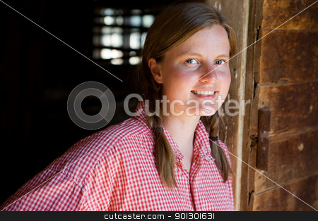 Farm Worker stock photo, A farm girl worker taking a break by Tyler Olson
