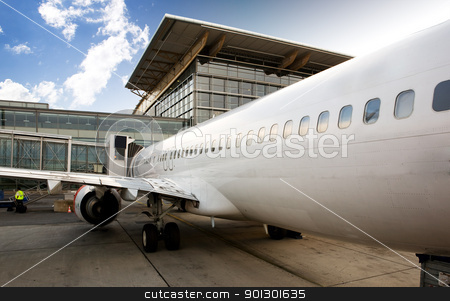Airplane Terminal stock photo, An airplane at a terminal gate ready for boarding by Tyler Olson