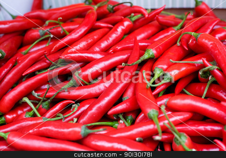 Fresh Hot Peppers stock photo, A bulk display of hot red peppers by Tyler Olson