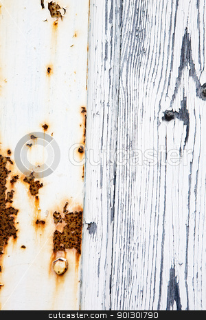 Rust and Wood stock photo, And old door with weathered white paint and rusting metal by Tyler Olson