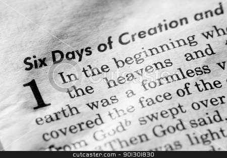 In the Beginning stock photo, Genesis 1:1 - In the beginning, and old, used bible by Tyler Olson
