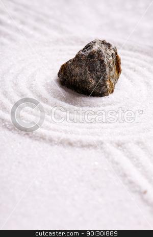 Rock on Sand stock photo, A rock in sand - zen rock garden by Tyler Olson