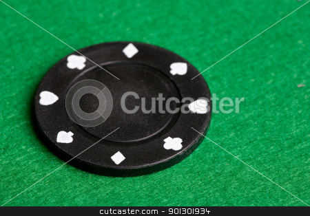 Black Poker Chip stock photo, A black $100 poker chip on green felt by Tyler Olson