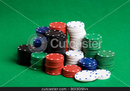 Poker Chips Stack stock photo, A large stack of poker chips on a green felt by Tyler Olson