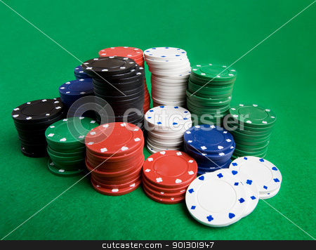 Poker Chips stock photo, A large stack of poker chips on a green felt by Tyler Olson