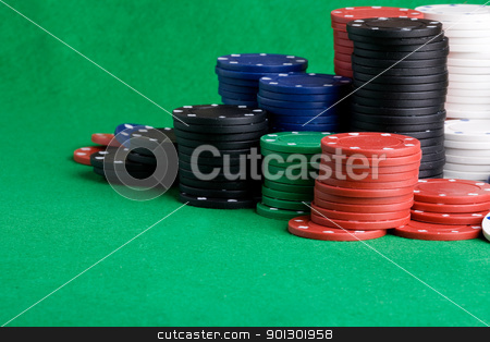 Casino Chips stock photo, Casino Chips on green felt background by Tyler Olson