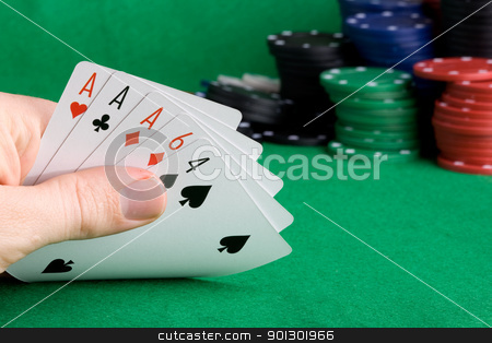 Three of a Kind stock photo, A poker hand with three of a kind Aces by Tyler Olson
