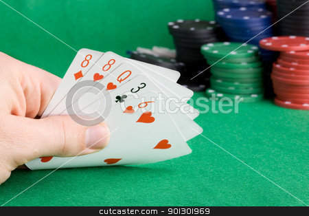 One Pair stock photo, A poker hand with one pair - a poker player looking at his cards by Tyler Olson