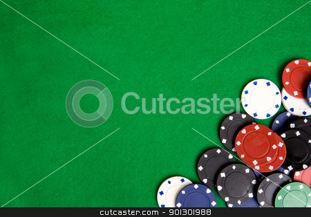 Casino Chip Background stock photo, Casino chips on a green felt - background image by Tyler Olson