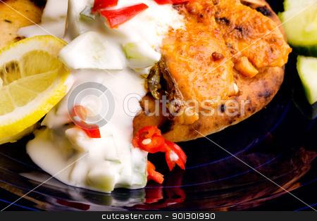Salmon Tikka stock photo, A tantalizing salmon tikka with fresh raita cucmber yogurt by Tyler Olson