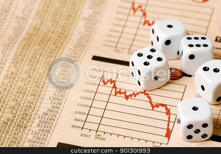 Stock Market Gamble stock photo, Dice and stock market charts in the newspaper by Tyler Olson