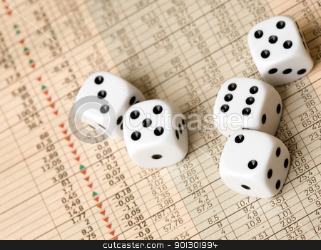 Stock Market Dice stock photo, Dice and stock market charts in the newspaper by Tyler Olson