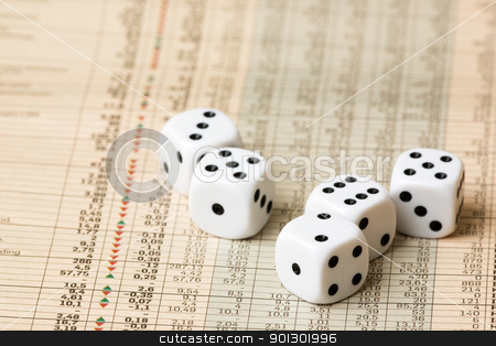Stock Market Decision stock photo, Dice and stock market charts in the newspaper by Tyler Olson