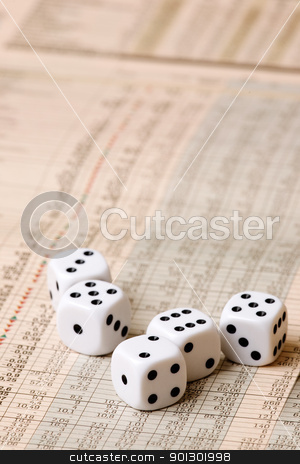 Dice and Stock Market Concept stock photo, Dice sitting on a stock market chart by Tyler Olson