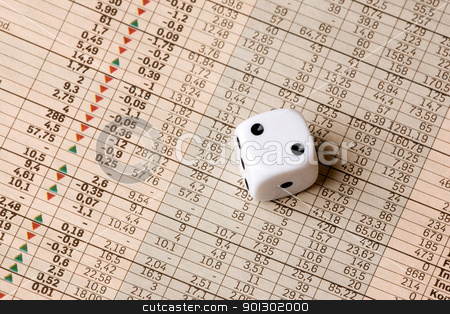 Dice and Stock Market Concept stock photo, A dice sitting on a stock market chart by Tyler Olson