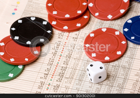 Stock Market Gamble stock photo, dice and casino chips on a stock market chart by Tyler Olson