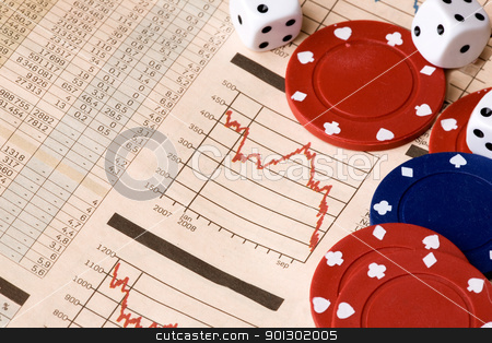 Stock Market Decision stock photo, dice and casino chips on a stock market chart by Tyler Olson