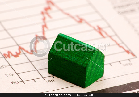 Housing Market Risk stock photo, Housing market concept image with graph and toy house by Tyler Olson