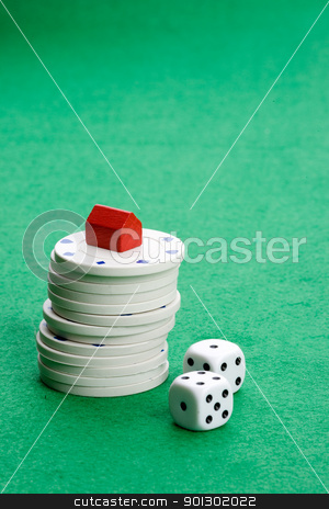 Risk Real Estate stock photo, Casino chips with toy house - housing market gamble concept by Tyler Olson