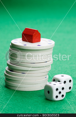 Risk Real Gamble stock photo, Casino chips with toy house - housing market gamble concept by Tyler Olson