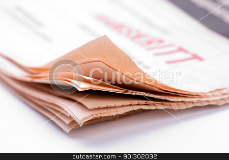 Newspaper Detail stock photo, Detail of the corner of a newspaper over white by Tyler Olson