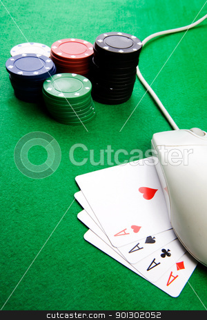 Online Gambling Concept stock photo, Online gaming and gambling concept, green felt, a mouse and cards by Tyler Olson